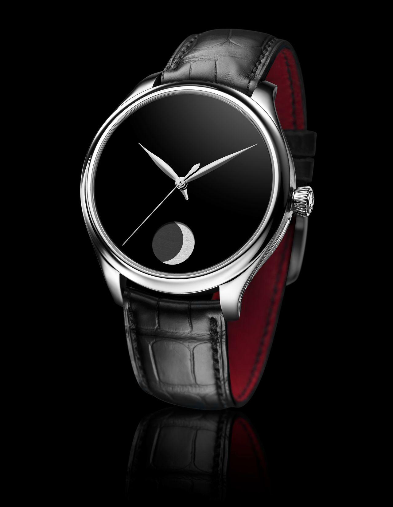 H. Moser & Cie. Endeavour Perpetual Moon Concept - a szíj piros belső borítása sokat old a monokróm színvilág szigorán, bár az órát viselve nyilván nem látszik